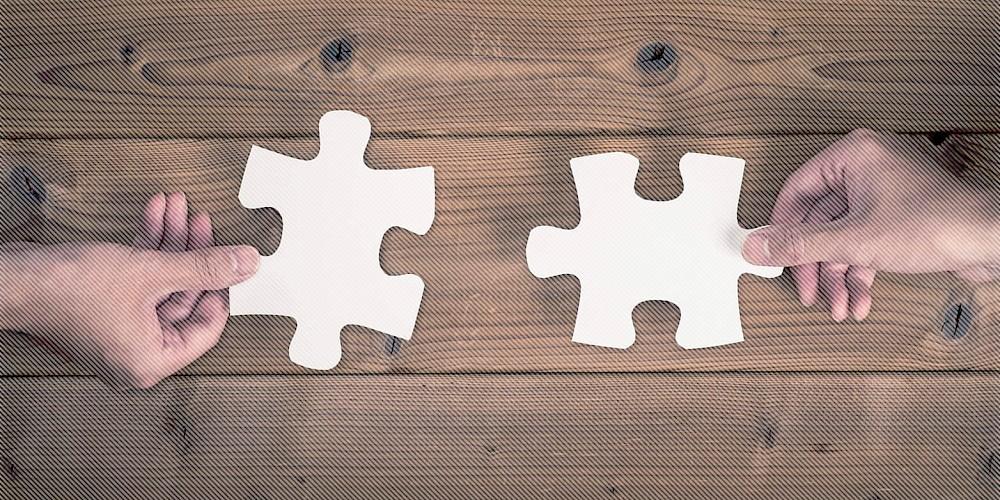 Hände Puzzleteile